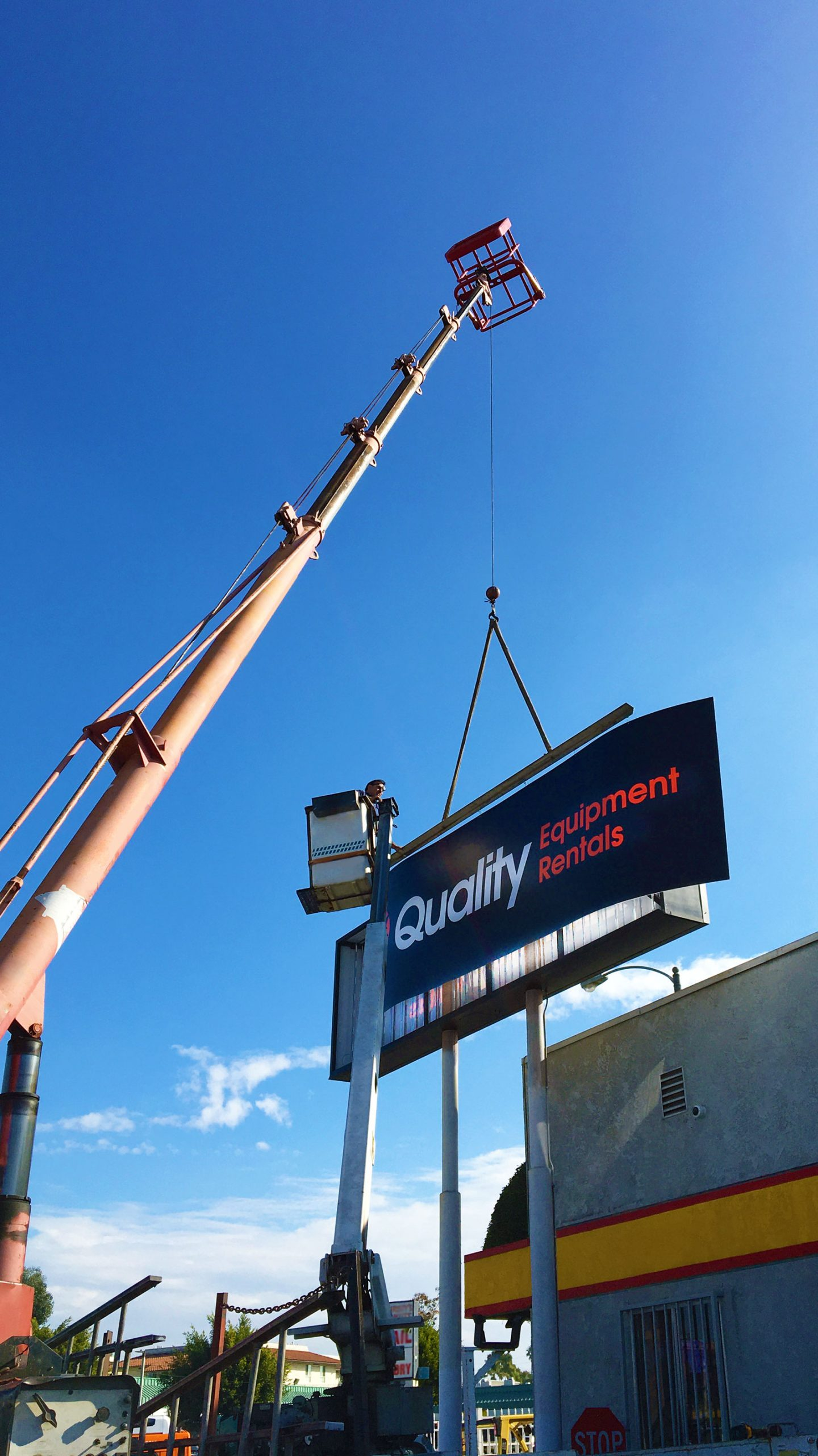 Installation of a large pylon sign with a crane