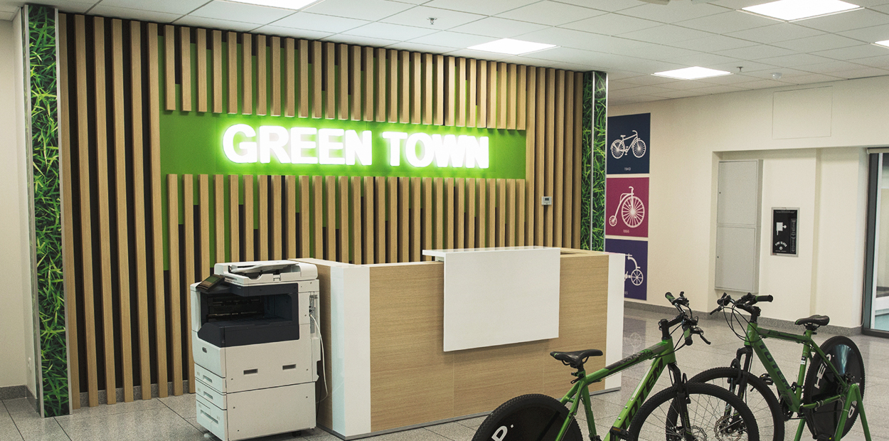 Green Town sustainable brand campaign with natural wall graphics