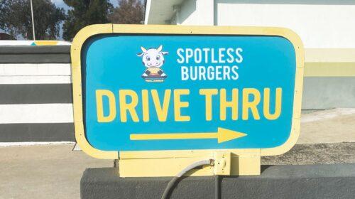Spotless burgers directional sign