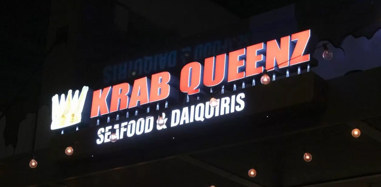 Displaying how LED lighting affects light box sign cost with the Krab Queenz outdoor advertising example