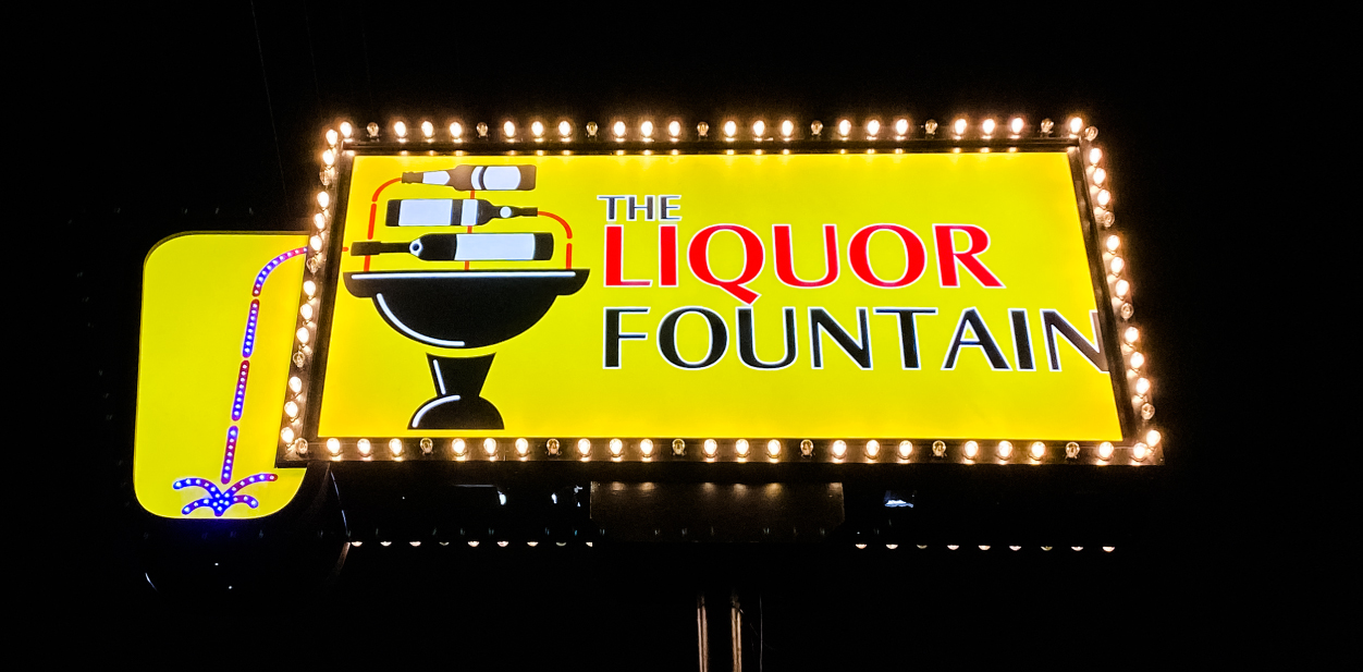 Displaying how color quality affects light box sign cost with the Liquor Fountain bright yellow cabinet example