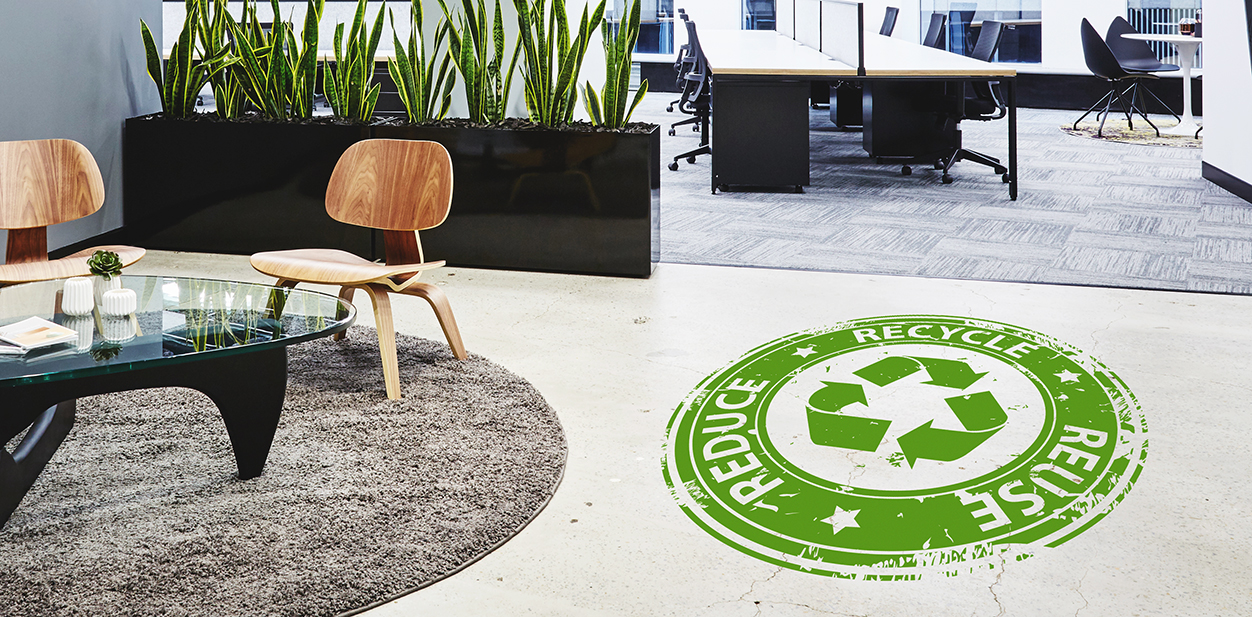Green marketing concept graphic displayed on a company floor