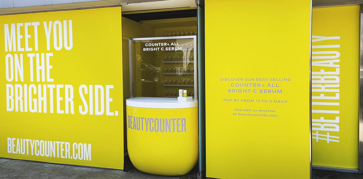 Beautycounter storefront design and window branding in yellow