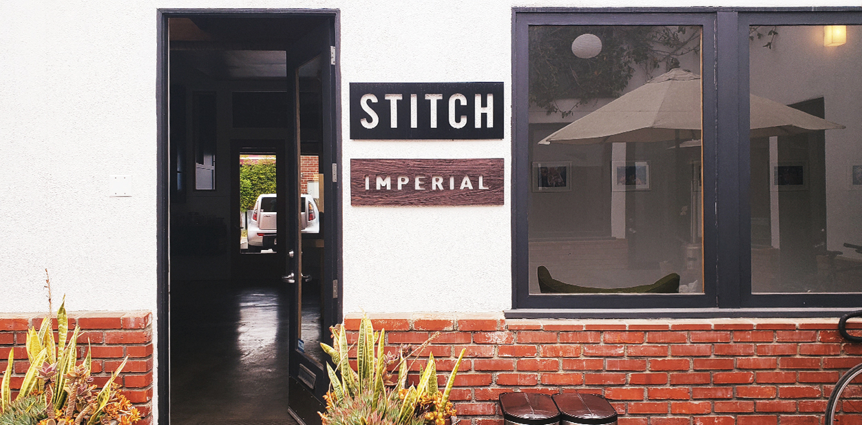 Imperial storefront branding with wood
