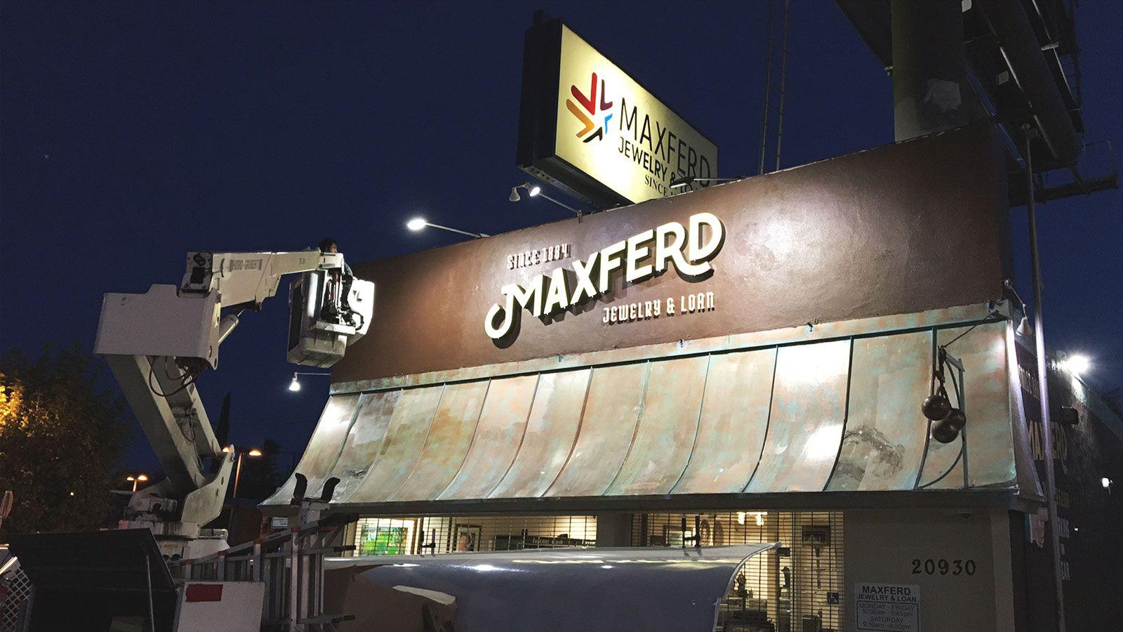 Maxferd storefront sign installation