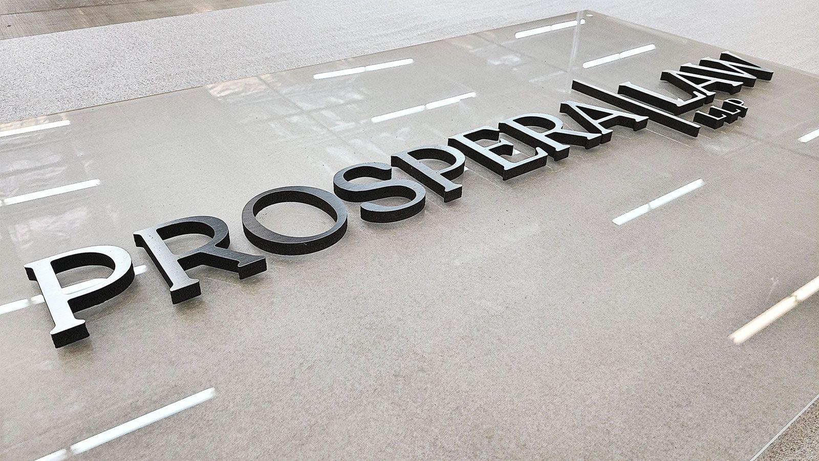 Prospera Law acrylic nameplate