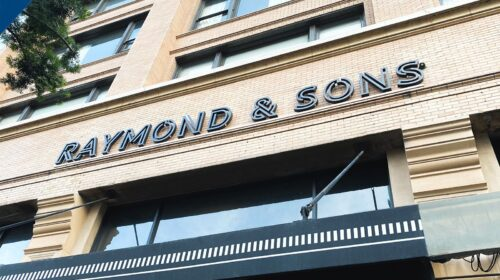 Raymond and Sons storefront sign