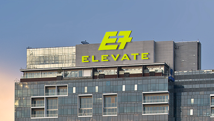 Elevate building top sign in electric green displaying the brand and logo