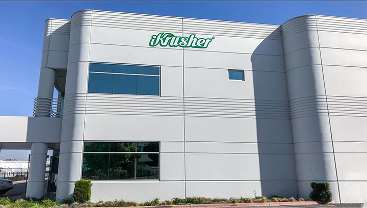 iKrusher corporate building high rise sign in green made of aluminum