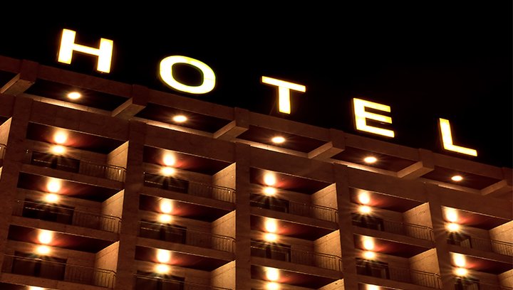 hotel building top signage with illumination