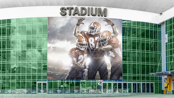 stadium tower sign with brand name letters and sport graphics