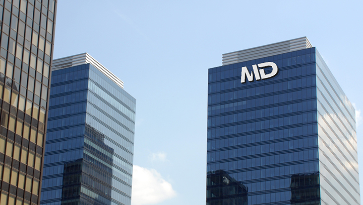 MD tall tower sign in white displaying the brand logo