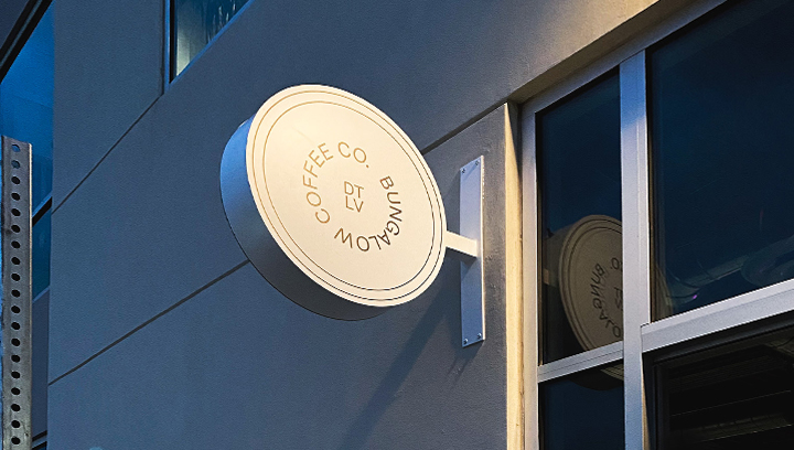 Bungalow Coffee Shop building blade sign in a round shape made of aluminum and acrylic