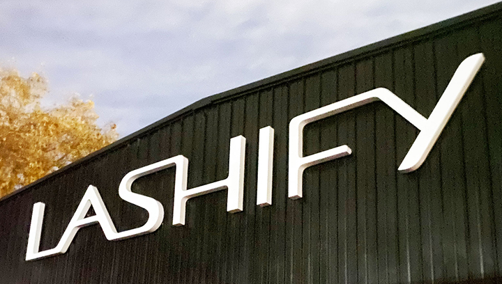 Lashify building letters in white displaying the brand name made of acrylic and aluminum