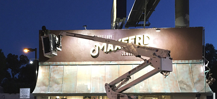 Maxferd lighted building sign's repair and replacement process