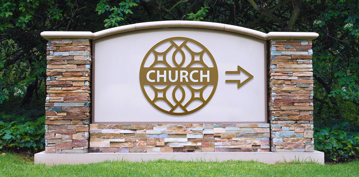 Large church directional sign with a custom shape logo