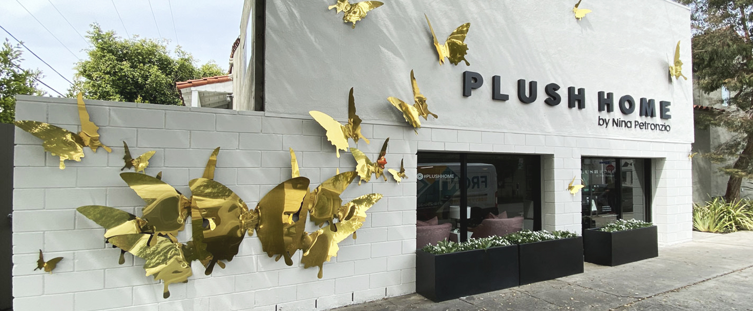 Plush Home custom building sign with golden decorative butterflies made of aluminum