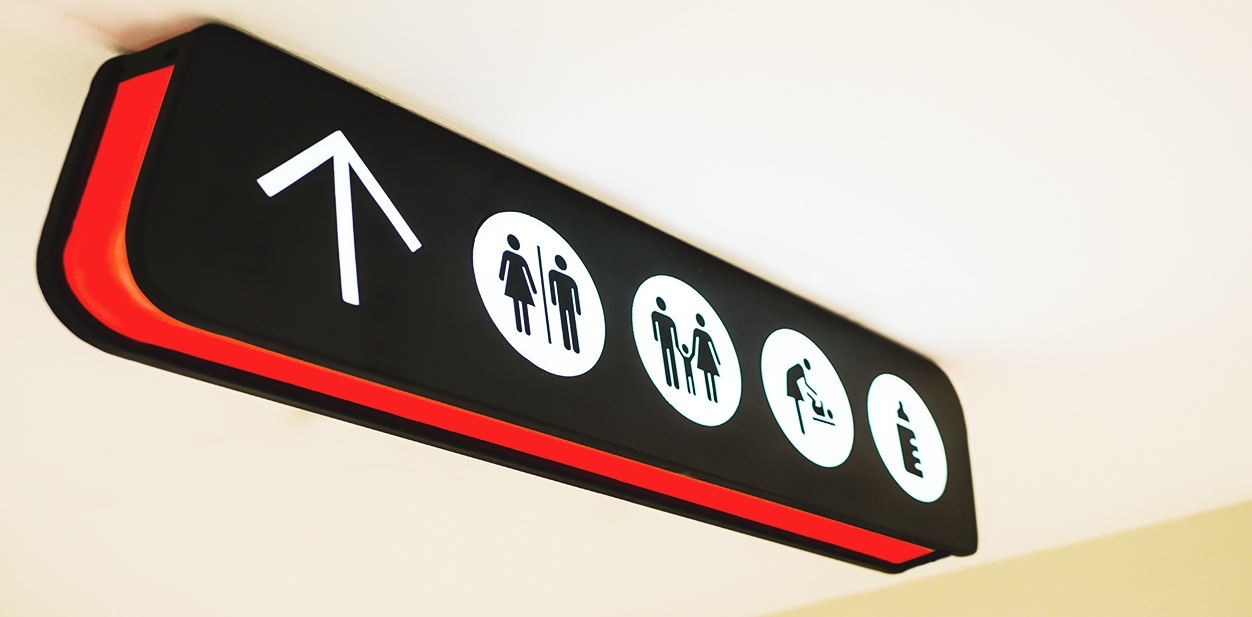 Hanging directional sign in black and red