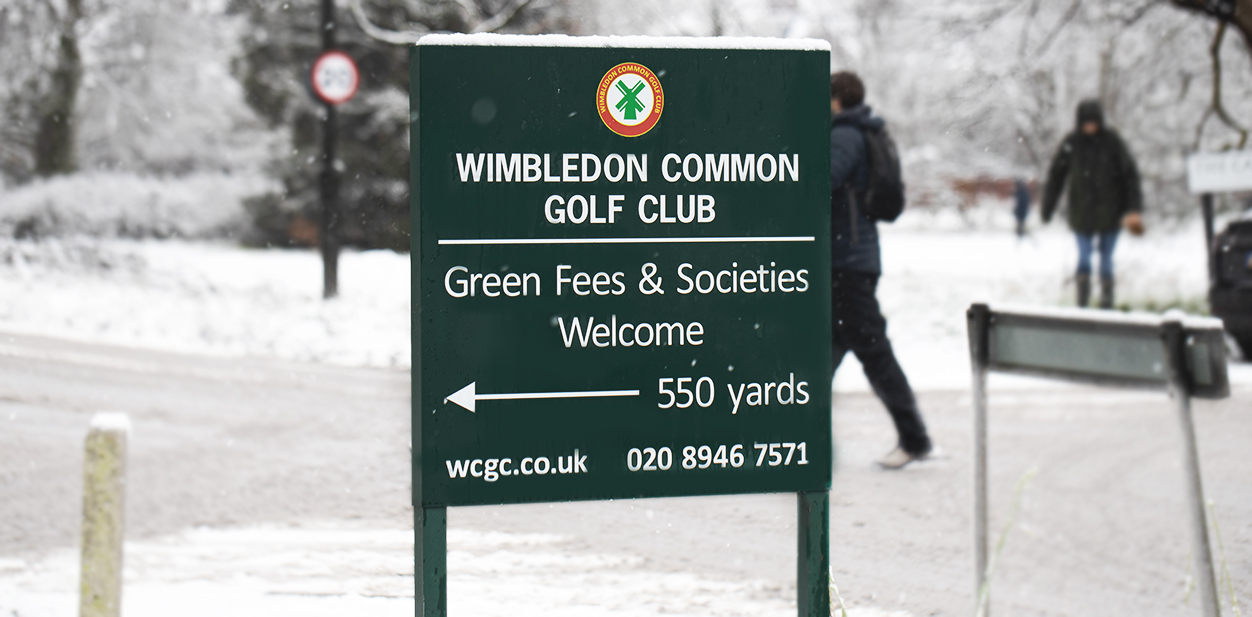 Outdoor golf course directional sign in a free standing style