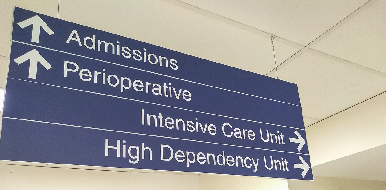 Hanging directional signage for hospital pointing at different departments