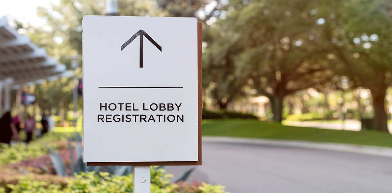 Hotel directional signage pointing at the lobby registration