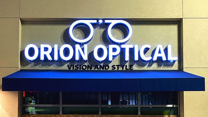 Orion Optical illuminated building sign made of aluminum and acrylic