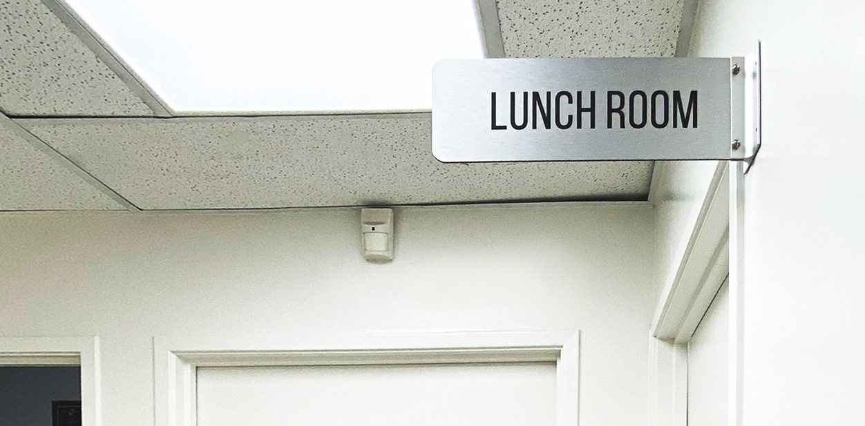 Lunch Room aluminum wayfinding sign in a wall-blade style