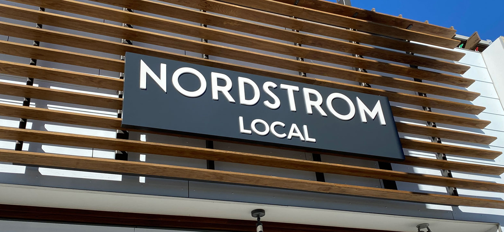 Nordstrom Local commercial building sign with white letters made of aluminum and acrylic