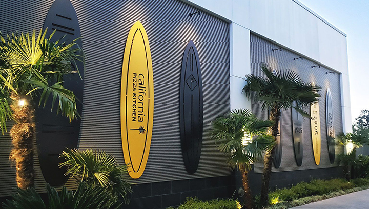 California Pizza Kitchen custom outdoor building signs in surfboard shapes made of aluminum