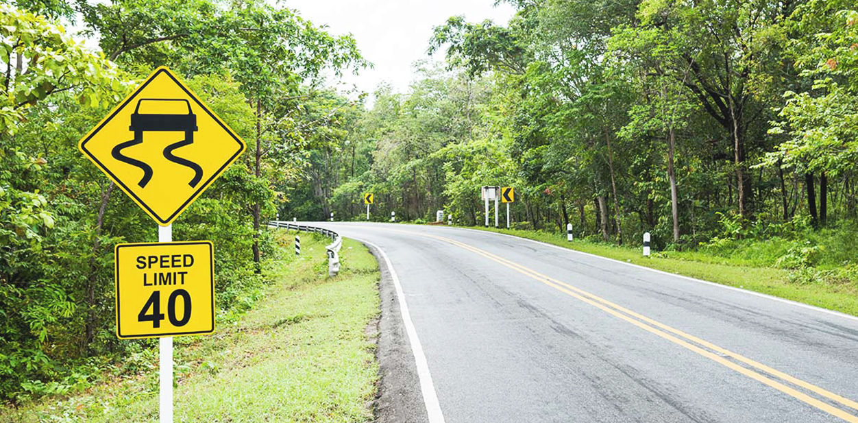 Regulatory wayfinding signs in yellow displayed at the roadside