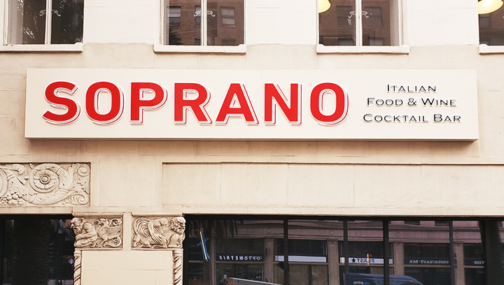 Soprano restaurant building sign with red brand name letters made of aluminum and acrylic