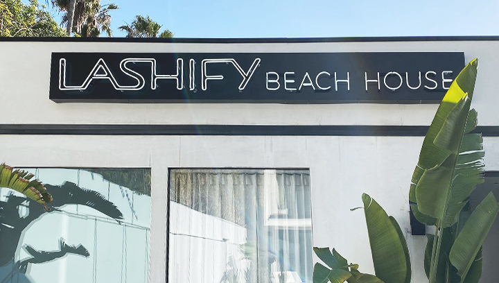 Lashify retail store building sign in a neon style made of aluminum