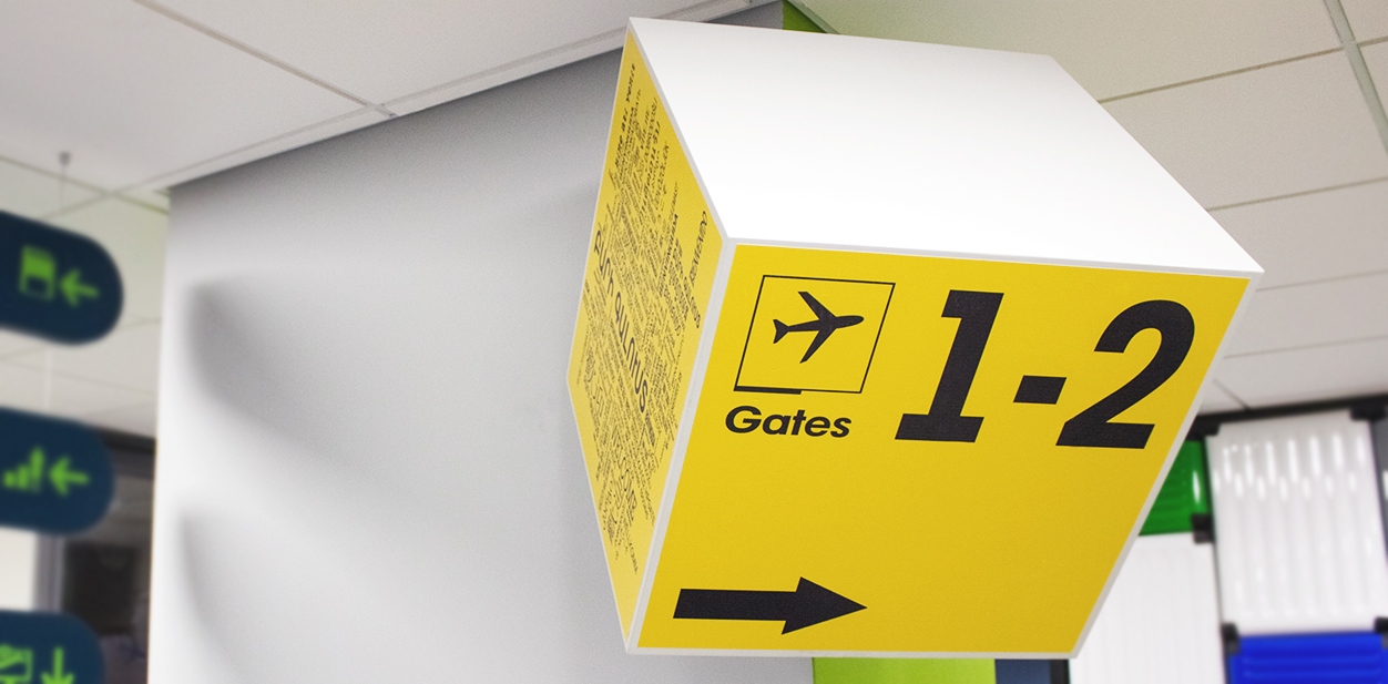 Custom wall mounted wayfinding sign in a box shape made of PVC and opaque vinyl
