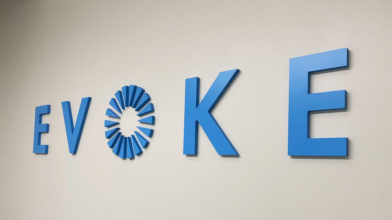 Evoke office acrylic sign