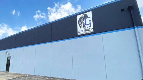 G & J Grip aluminum sign