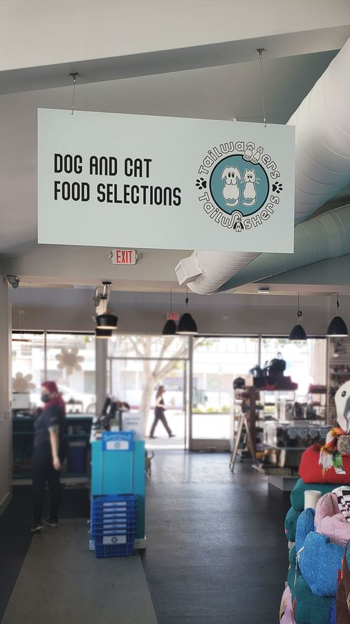 Tailwaggers hanging dibond sign