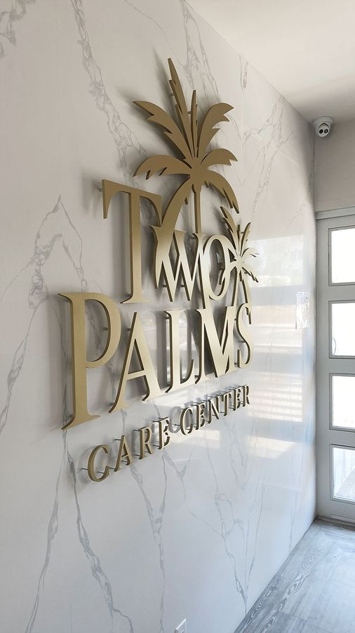 Two palms pin-mounted letters
