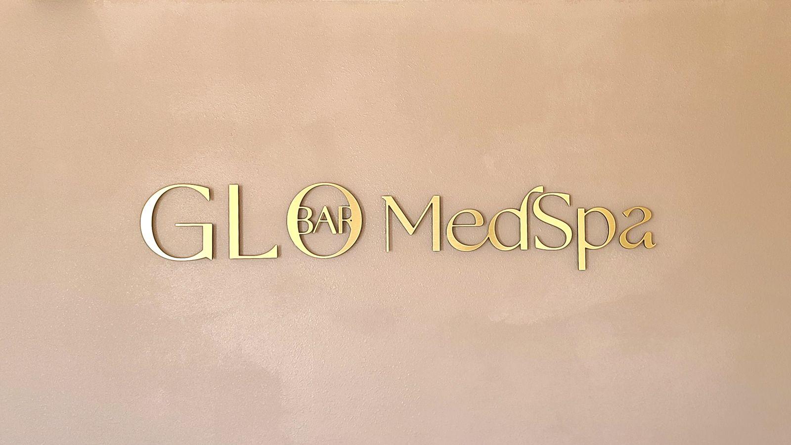 glo bar medspa office sign