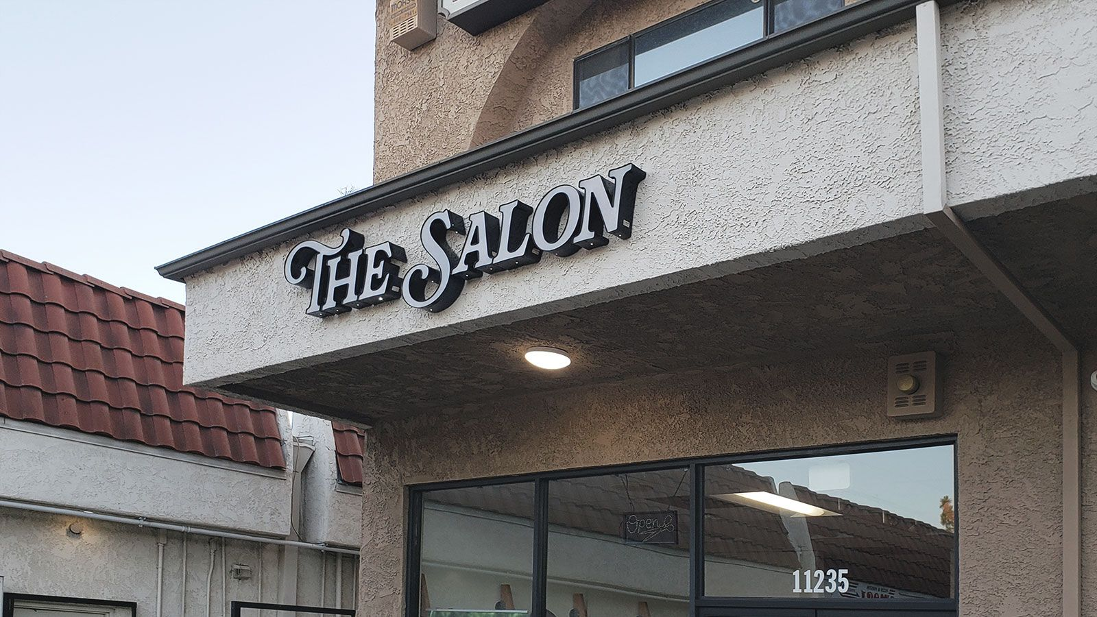 the salon store sign