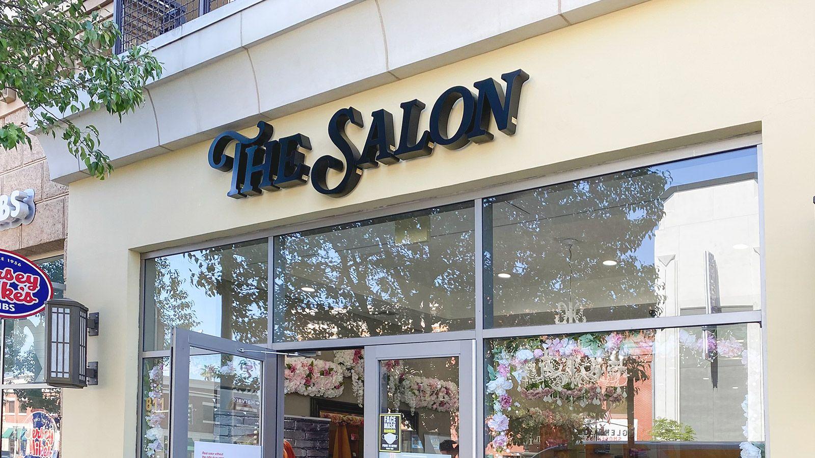 the salon storefront sign