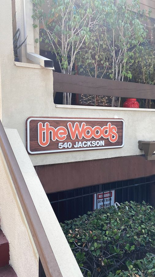 the woods pvc sign