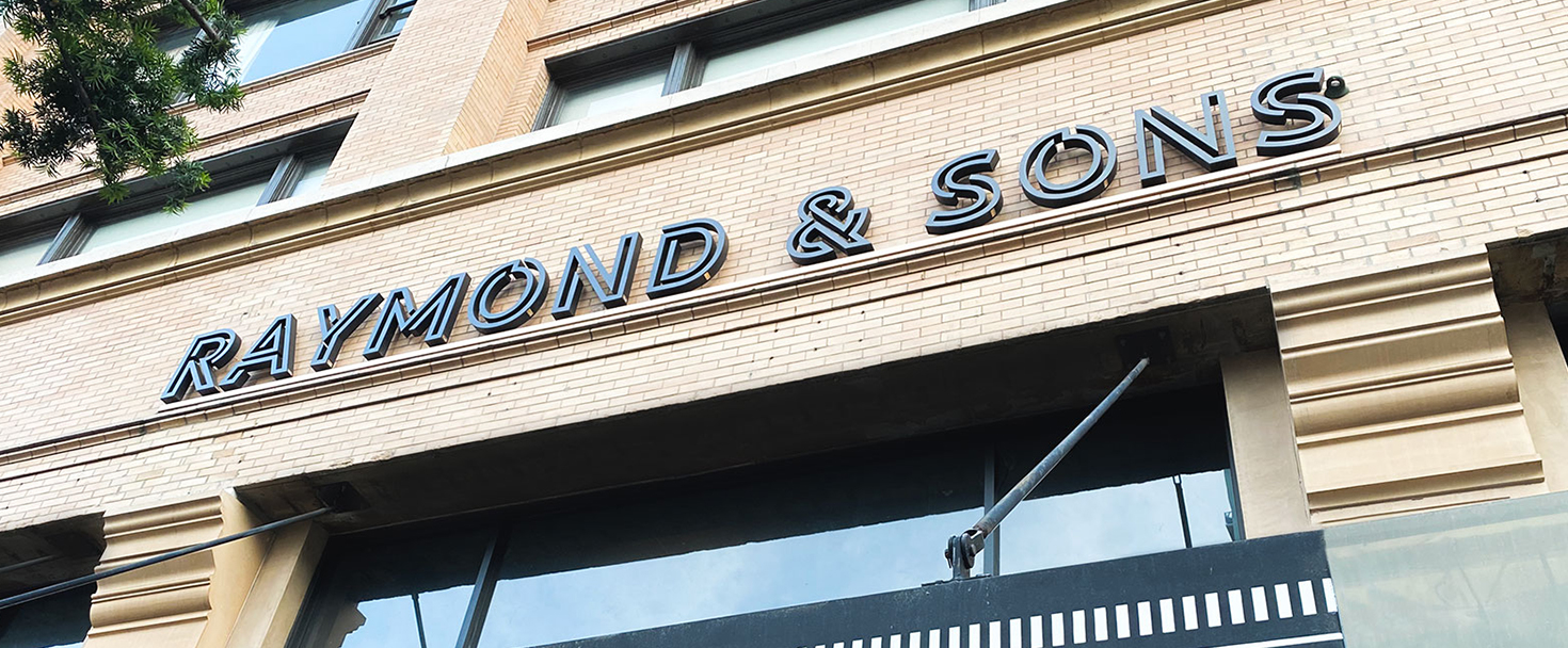 Raymond and Sons architectural sign made of aluminum for storefront branding