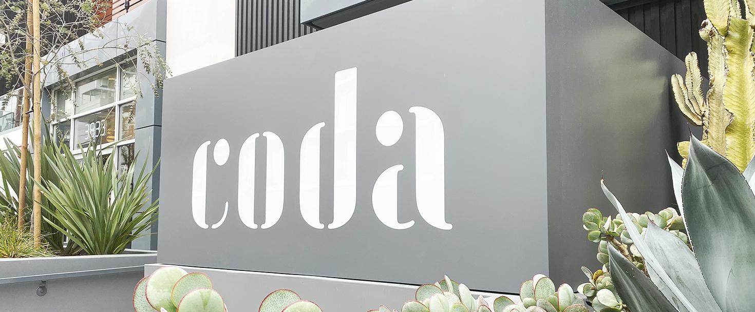 Coda illuminated architectural signage in a big size made of aluminum and acrylic