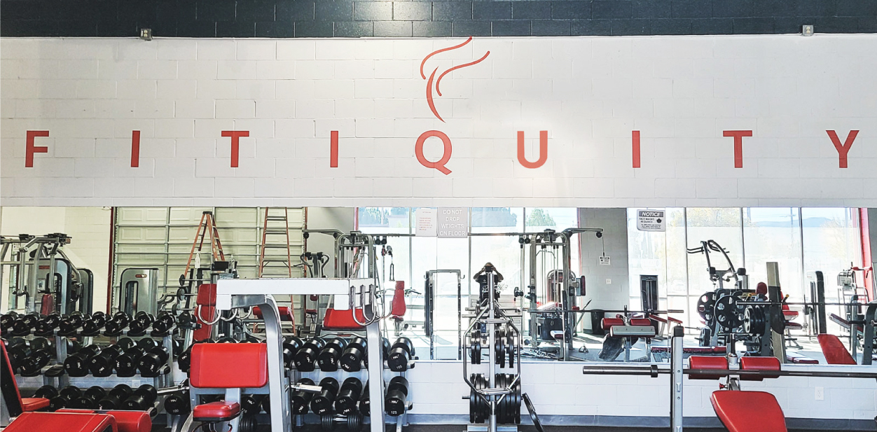 Fitiquity gym exercise room branding sign in red displaying the brand name