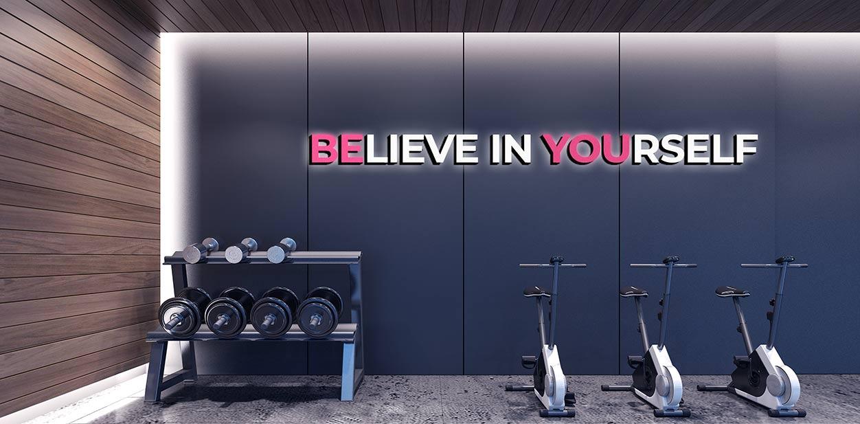 Gym interior design idea displaying a motivational phrase
