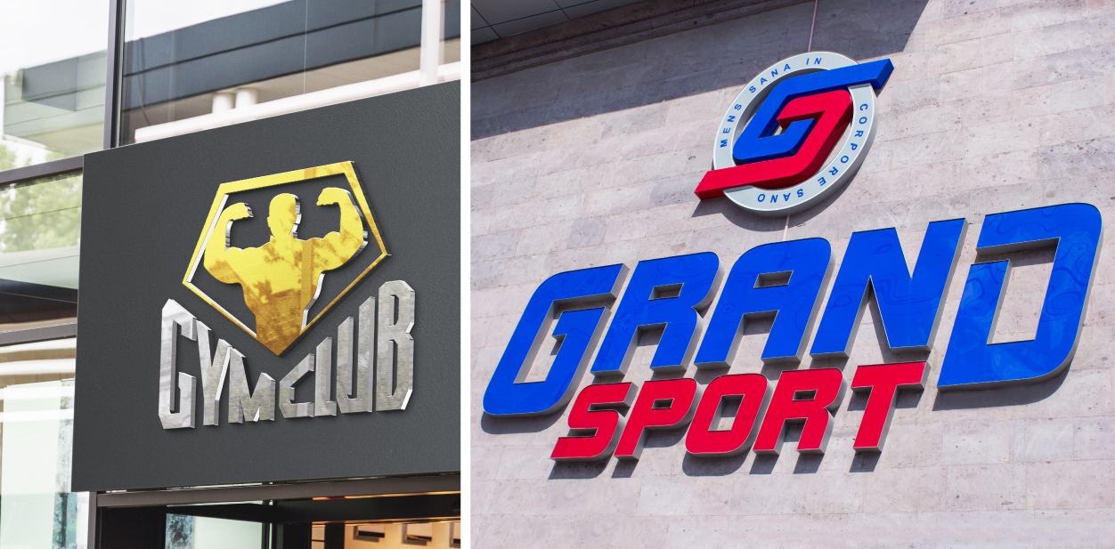 Gym building signs in a big size displaying brands' names and logos