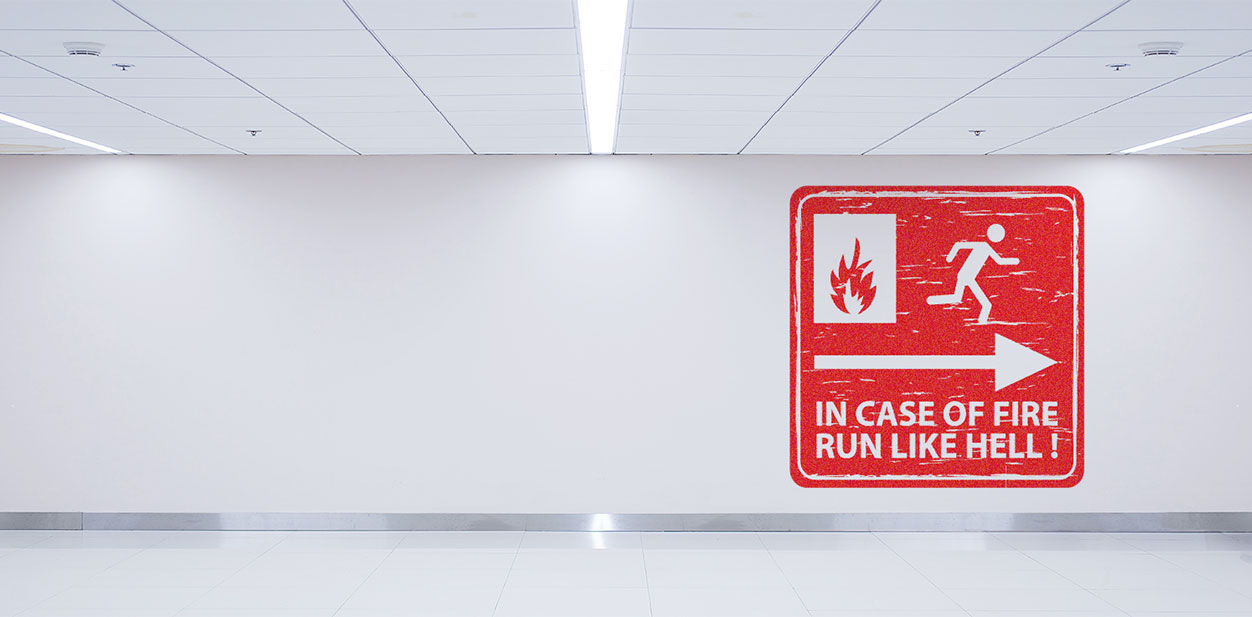 Gym interior design with a red safety notice