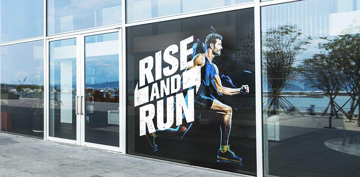 Gym window design idea displaying motivational graphics