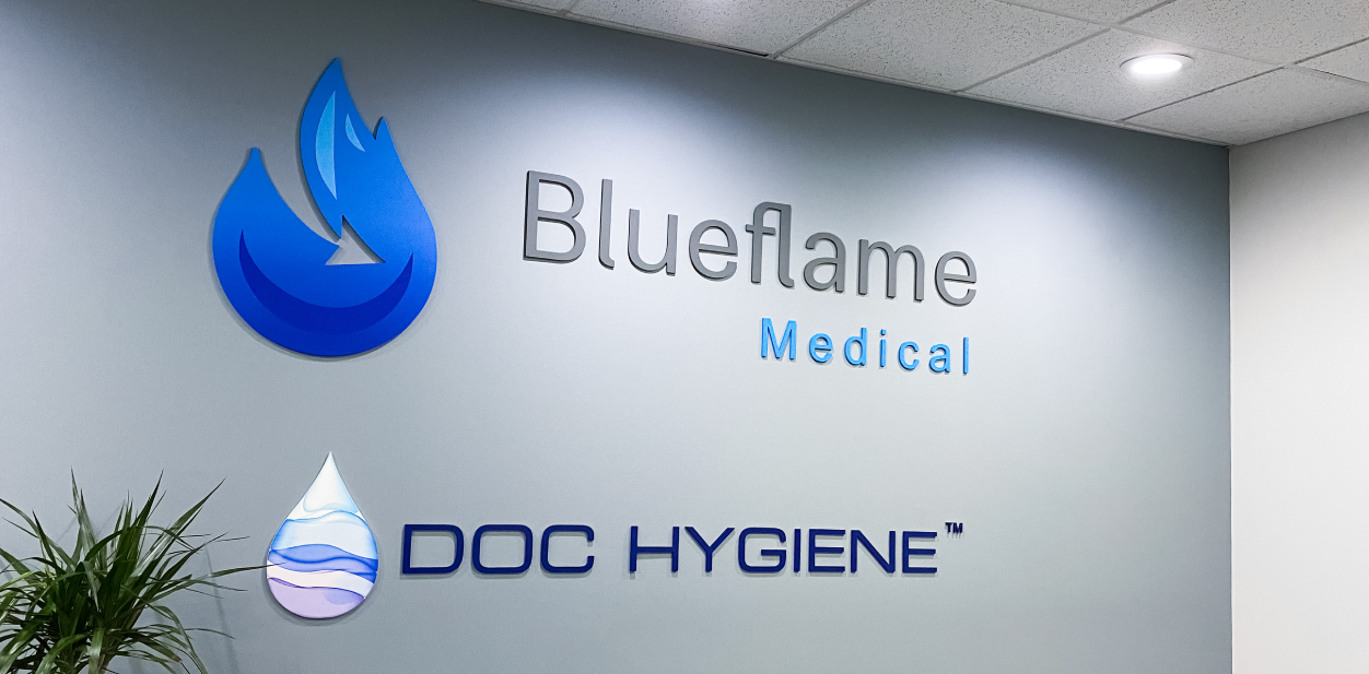 Blueflame indoor medical office signs displaying the brand name and logo