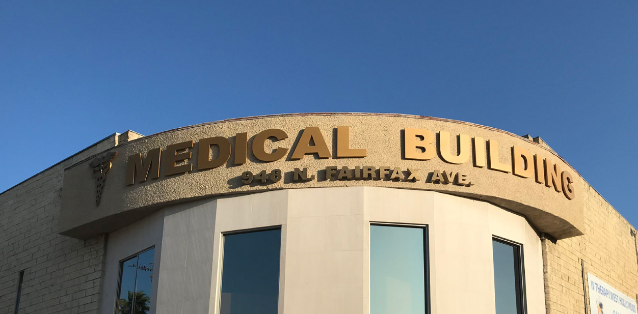 Golden colored medical building signs in a big size